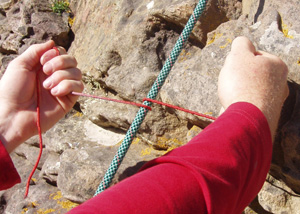 A short (30cm) piece of thin (2-3mm) nylon cord can cut a loaded rope in just 3 seconds