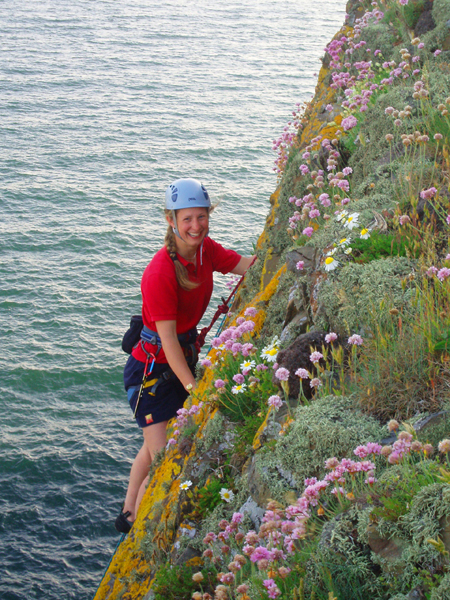 Climbing through the flowers at Fox Craig, Meikle Ross.