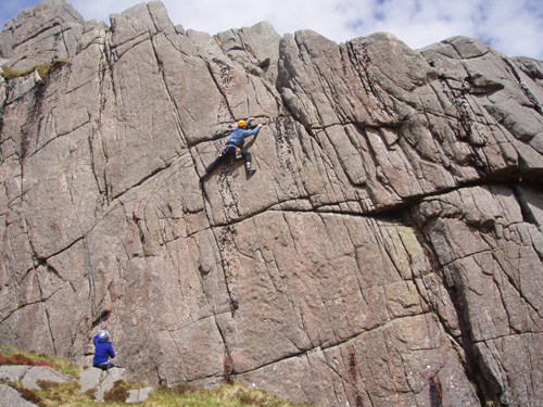 John Biggar on the first ascent of General Dynamics, E1, Memorial Crag, Craignaw