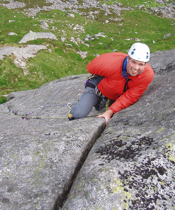 James Kinnaird about to start the tenuous top toe traverse on Sprauchlers Groove.