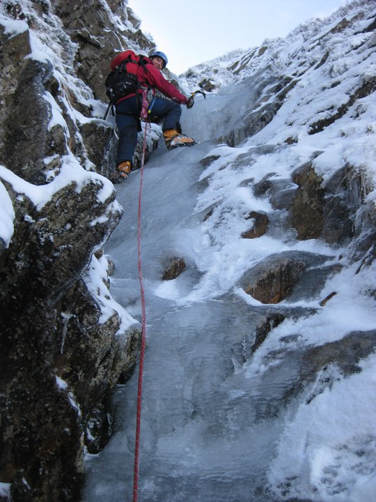 Linda leading good ice at the top of Better Gully, December 2010.