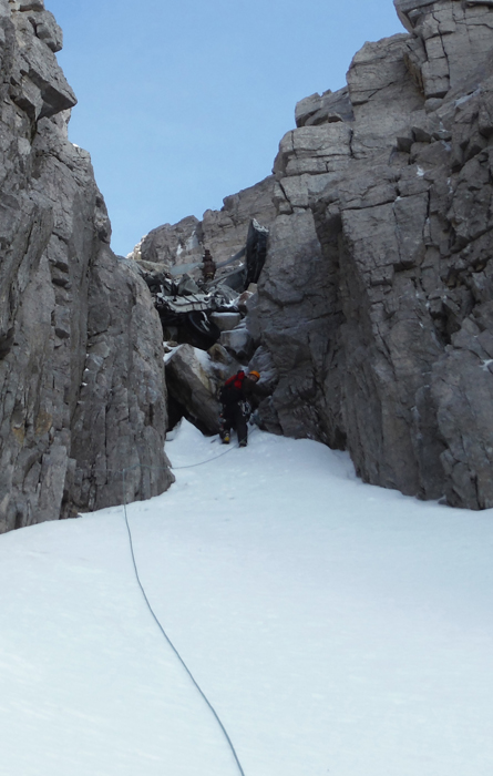 Climbing up to the aircrafft wreckage  in Fuselage Gully on Beinn eighe, Scotland.